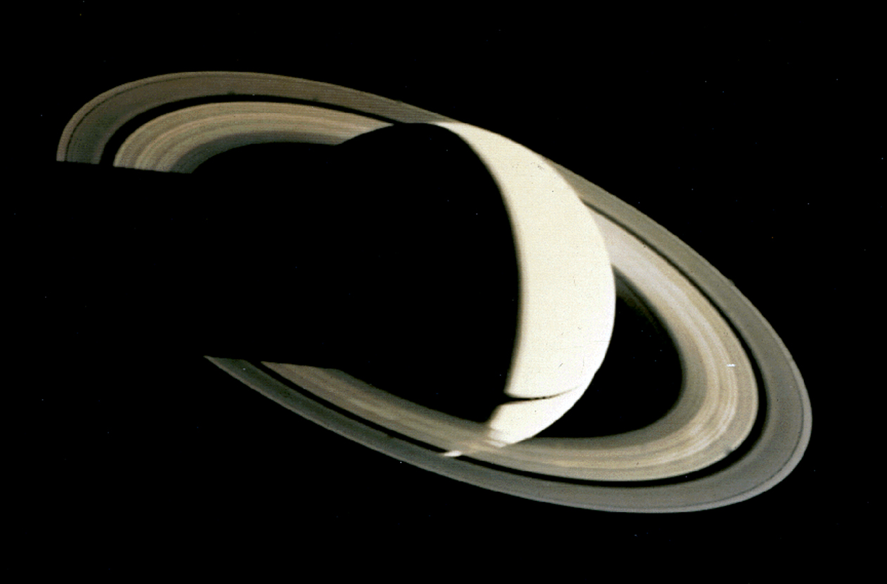 Crescent_Saturn_as_seen_from_Voyager_1